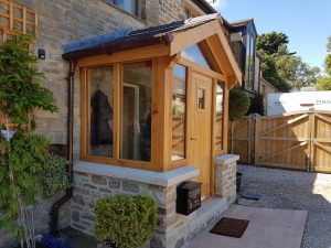 Solid osk porch with new gates